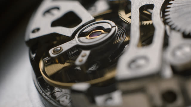 watch tourbillon rotating macro slowmotion - часть машины стоковые видео и кадры b-roll