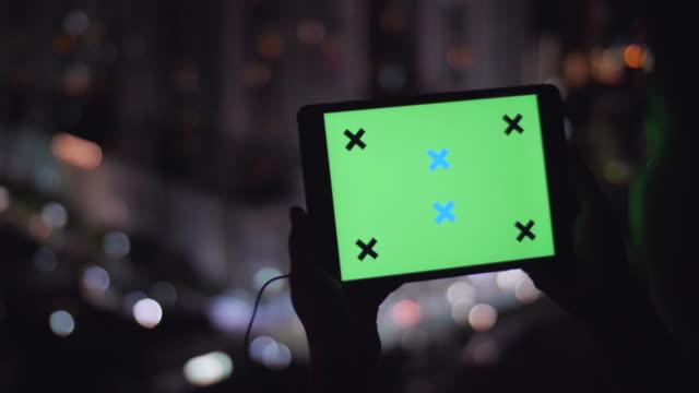 watching green screen at night - christmas movie video stock e b–roll