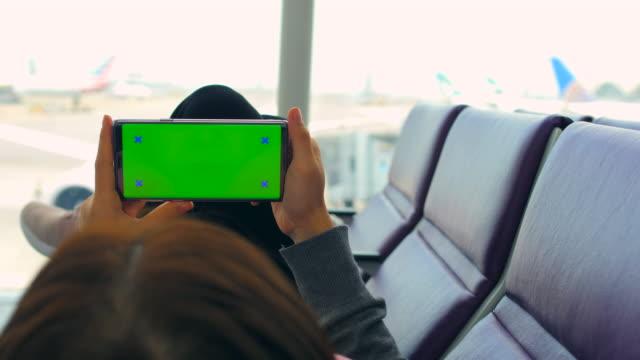 Watching Phone at Terminal Airport,Green screen