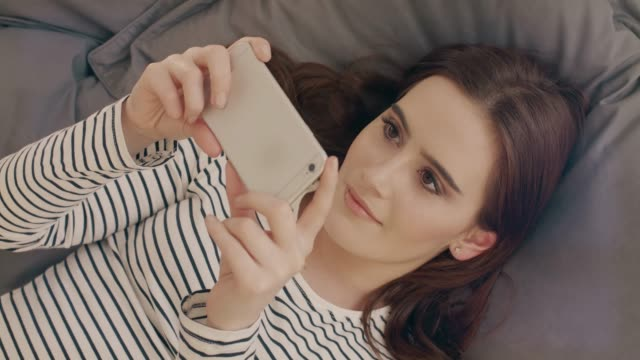 Watching tv on smartphone, lying down. video