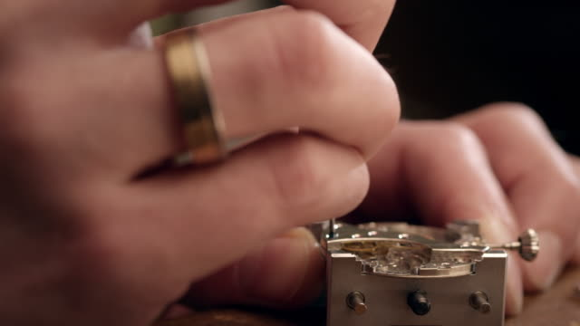 Watchmaker assembling watch Selected Takes - Shot on RED Epic instrument of time stock videos & royalty-free footage