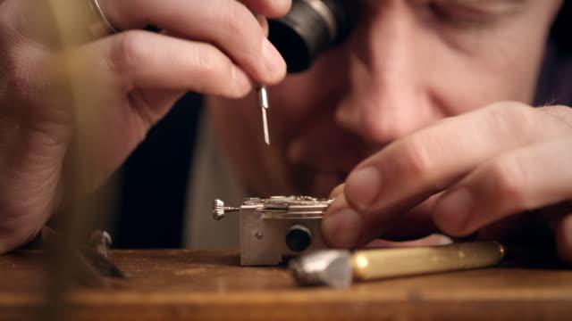 Watchmaker assembling watch video