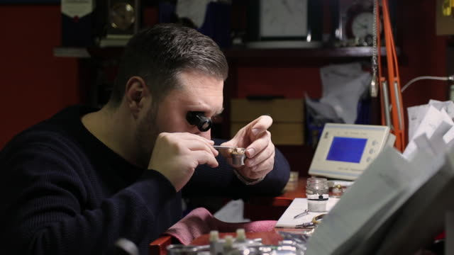 Watchmaker repairing a vintage pocket watch