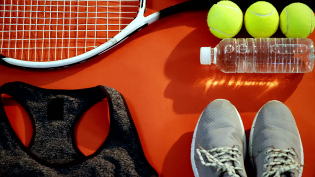 Water bottle, sports shoes and sports equipment in studio 4k video