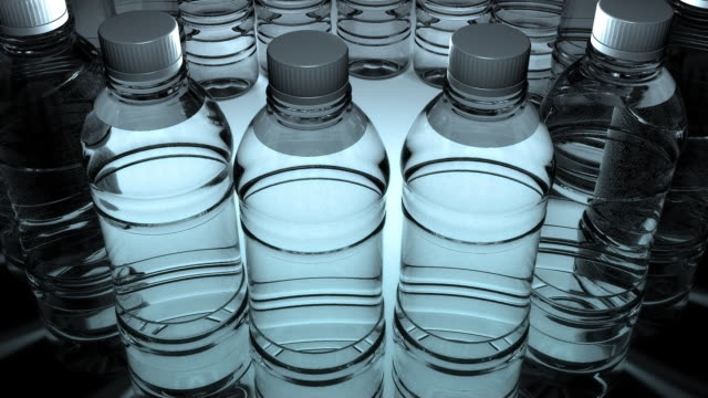 Water bottles slowly spinning (Loop) video