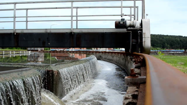 water clean mechanism Sewage waste water treatment cleanment mechanism move and filtering water flow in basin. purified water stock videos & royalty-free footage