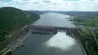 istock water discharge waterfall at the hydroelectric dam , Siberia, Krasnoyarsk, Russia. siberian nature, renewable energy reservoir 1323199480