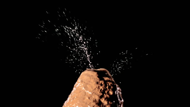 SLO MO LD Water drop falling onto stalagmite