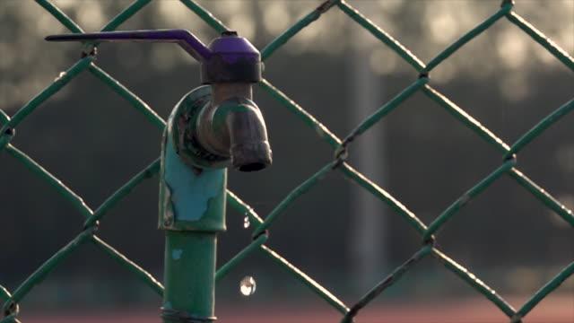 Water Drop From Old Faucet Slow Motion Loop Video of water drop from old faucet super slow motion loop able. 4K purified water stock videos & royalty-free footage