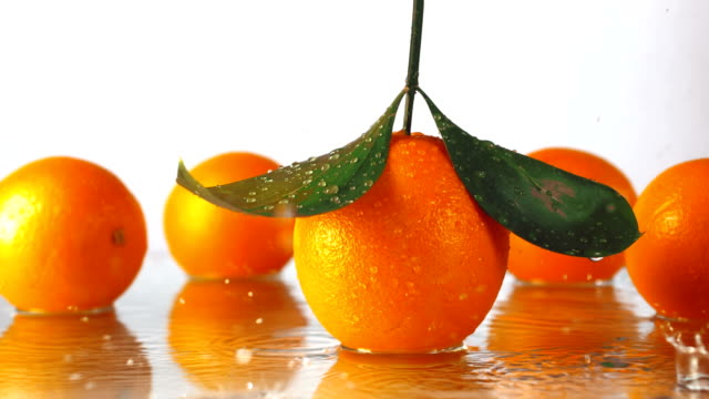 water drops on ripe oranges video