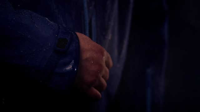 Water drops on Synthetic waterproof fabric. Fastening the zipper