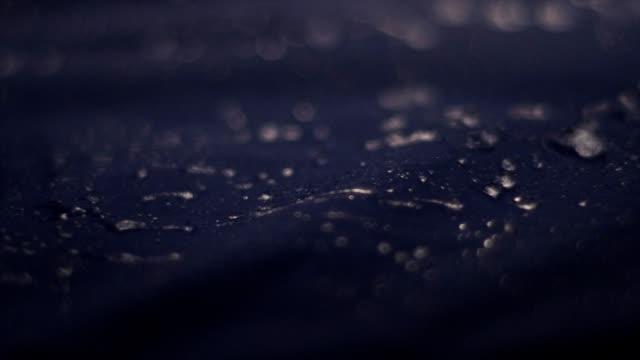 water drops on synthetic waterproof fabric. sports clothing close up - odzież sportowa filmów i materiałów b-roll