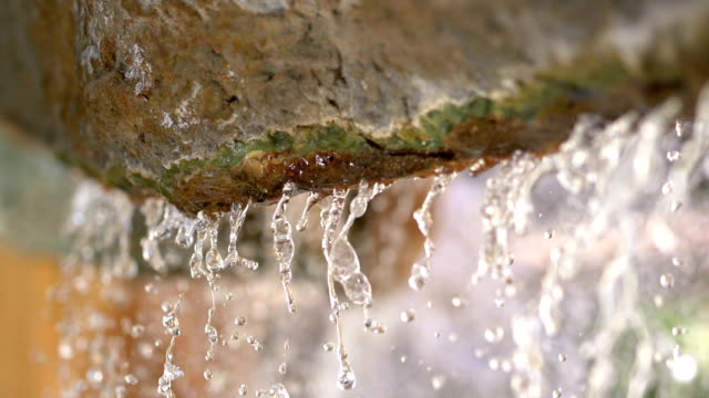 Water falling from the rock in slow motion 180fps video