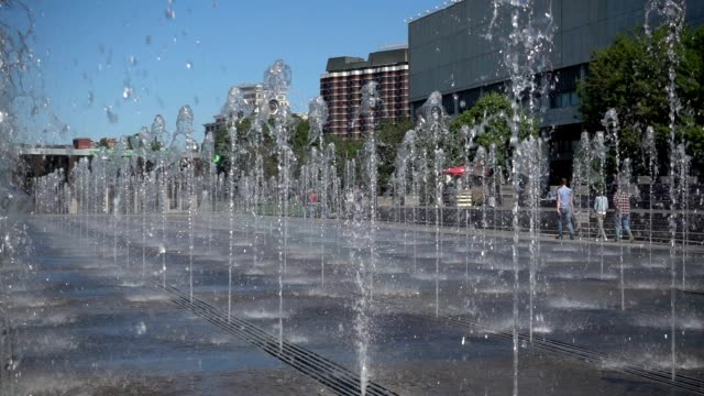 water feature fountain in the public park in from of the museum in sunny day, Slow motion
