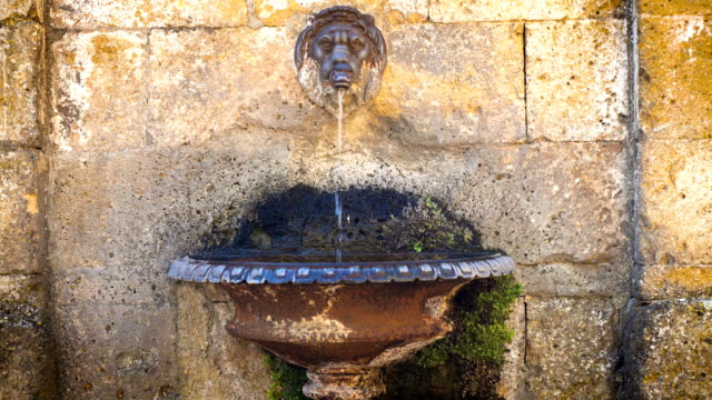 water flowing at the street fountain at the small italian town - classical architecture stock videos & royalty-free footage