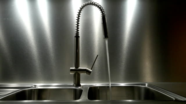 Water flowing out faucet into metal sink Water flowing out faucet into metal sink kitchen sink stock videos & royalty-free footage
