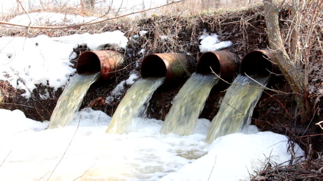 Water flows from large pipes video