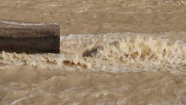 Water flows violently on concrete. video