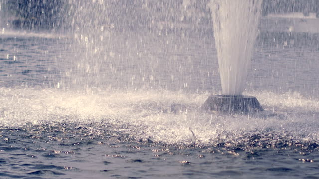 Water fountain in slow motion. Splashing streams of water fountain video