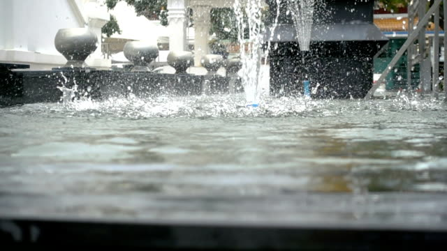 water fountain in super slow motion. - fontana struttura costruita dall'uomo video stock e b–roll