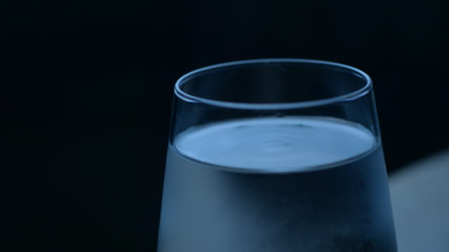 Water glass eartquake slowmotion Water glass eartquake slowmotion earthquake stock videos & royalty-free footage