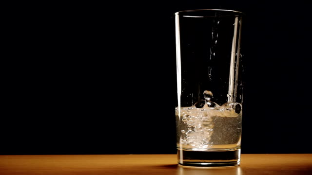 Water is slowly poured into a glass video
