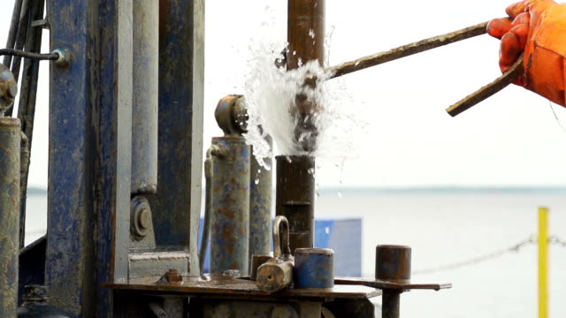 water jet breaking out drill pipe slow motion video