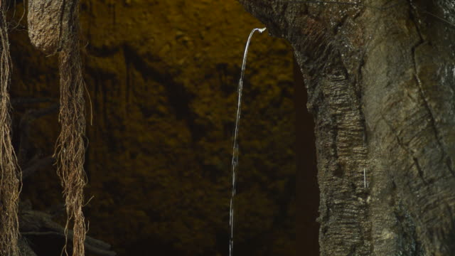 Water jet pouring from the rock in the heart of a mountain Water jet pouring from the rock in the heart of a mountain colloid stock videos & royalty-free footage