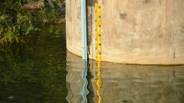 water level meter on cement wall for flood warning