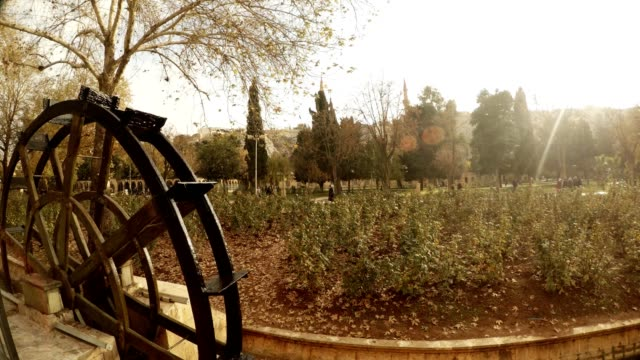 Water Mill Moves Setting Sun Shines on Flower-beds Urfa video