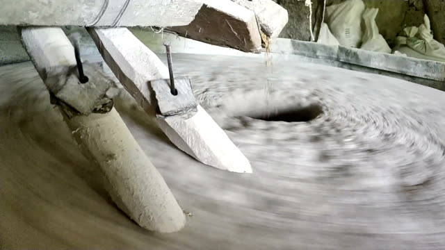 Water mill stone is grinding