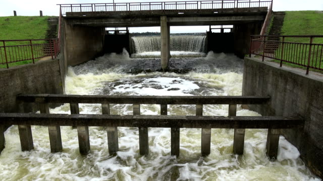 Water overflow in old river dam after rains video