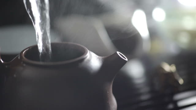 Water Pouring Into Clay Teapot video