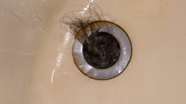 Water running into clogged bath plug hole video