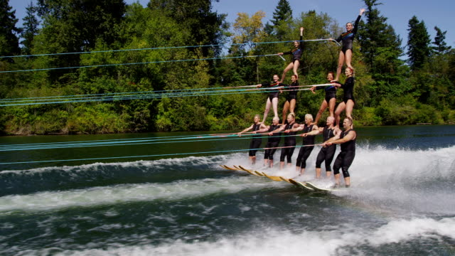 Water ski team in double pyramid formation