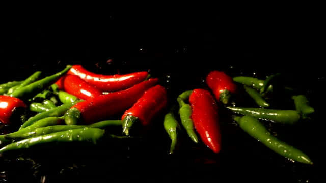Water Splash On Green And Red Chilies video