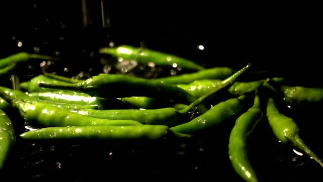 Water Splash On Green Chili Pepper video