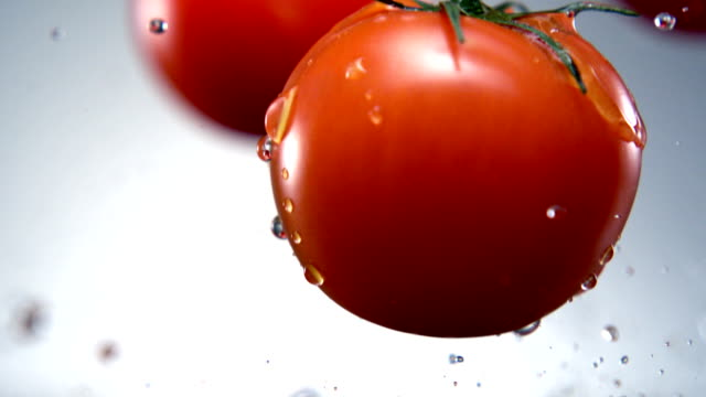 Water splash on tomato, Slow Motion video