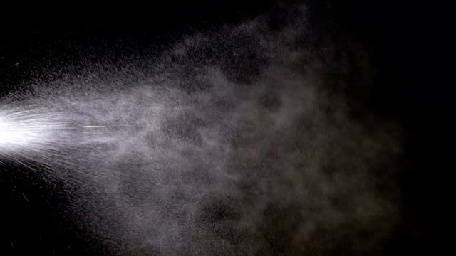 Water Spray against Black Background. Slow Motion