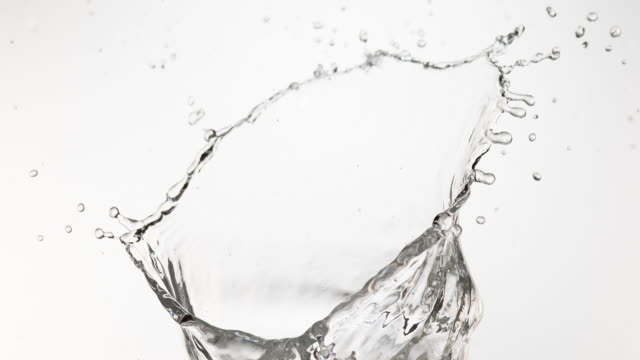 Water Spurting out against White Background, Slow Motion 4K Water Spurting out against White Background, Slow Motion 4K splashing stock videos & royalty-free footage