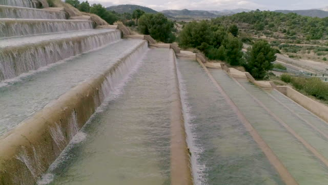 Water steps side view drone rising