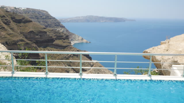Water surface at pool & Aegean seascape video