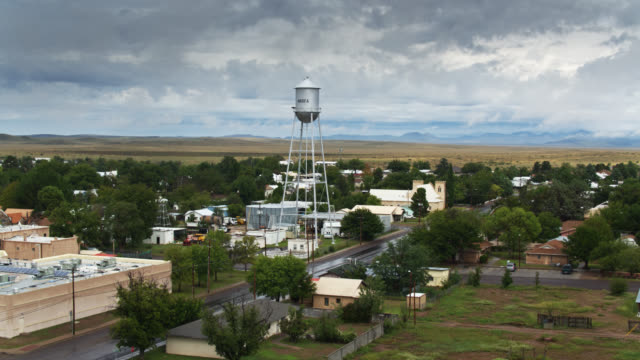 Water Tower Above Marfa, TX - Descending Drone Shot Establishing aerial shot of Marfa, a tiny town in West Texas that has become a noted cultural center known for land art installations and minimalist art. americana stock videos & royalty-free footage