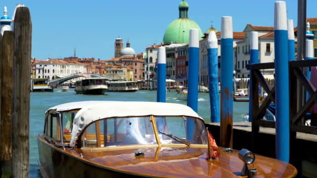 Water transport in Venice, beautiful motorboat floating in Grand Canal, tour video