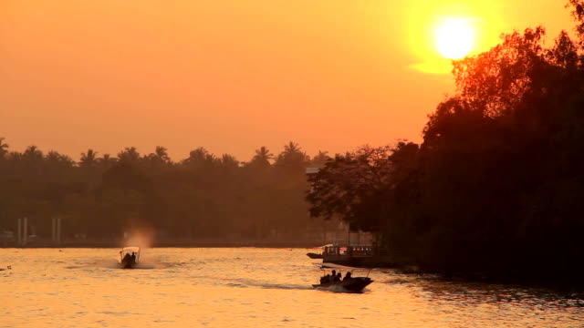 Water transportation with sunset background. video