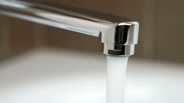 Water under strong pressure flows from a water tap video