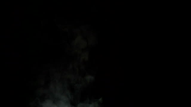 Water vapor tends upward White Steam rises from a large pot that is behind the scenes. Black background. Filmed at a speed of 240fps steam stock videos & royalty-free footage