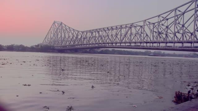 Water wave in polluted river ganga near howrah bridge ,Kolkata (India) at sunset time