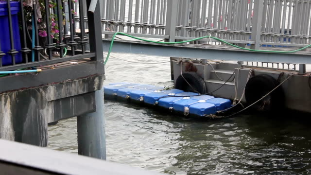Water wave touch pontoon in river video