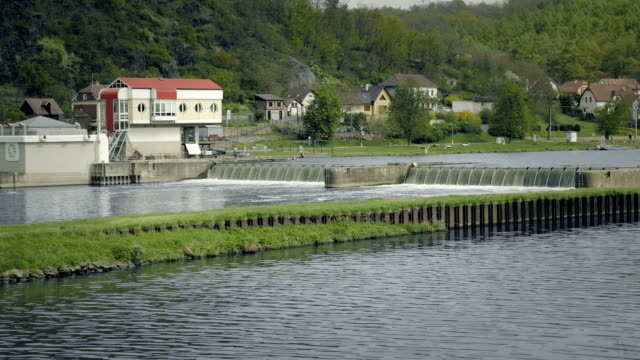 Water weirs, overflowing water into small dams, static shot. video